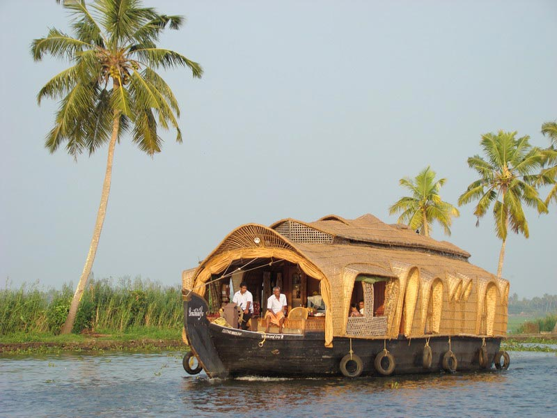 Houseboat met palm Backwaters